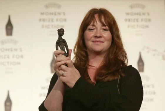 """Winning author Eimear McBride receives her award for her novel """"A Girl is a Half-Formed Thing"""" at the 2014 Bailey's Women's Prize for Fiction in London"""