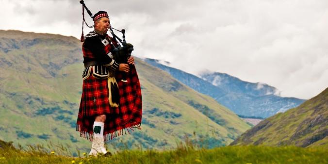 Highland bagpiper in kilt